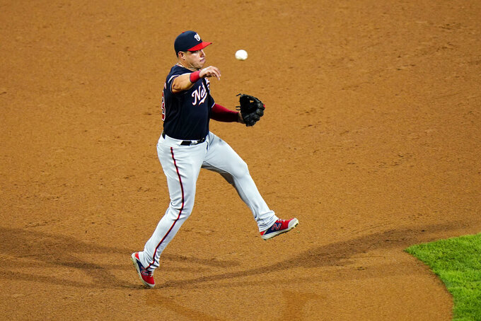 Washington Nationals third baseman Asdrubal Cabrera throws to first after fielding a ground out by Philadelphia Phillies' Andrew McCutchen during the third inning of a baseball game, Monday, Aug. 31, 2020, in Philadelphia. (AP Photo/Matt Slocum)