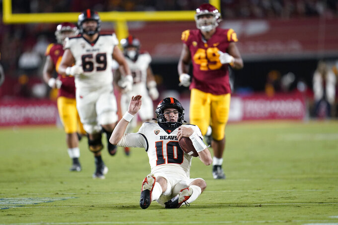 Oregon State quarterback Chance Nolan slides for a first down during the first half of an NCAA college football game against Southern California Saturday, Sept. 25, 2021, in Los Angeles. (AP Photo/Marcio Jose Sanchez)