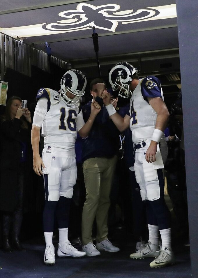 Los Angeles Rams' Jared Goff (16) and Sean Mannion pause in the tunnel before the NFL football NFC championship game against the New Orleans Saints, Sunday, Jan. 20, 2019, in New Orleans. (AP Photo/Carolyn Kaster)