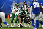New York Jets quarterback Zach Wilson (2) calls a play before the snap during the first half of the team's NFL preseason football game against the New York Giants, Saturday, Aug. 14, 2021, in East Rutherford, N.J. (AP Photo/Corey Sipkin)
