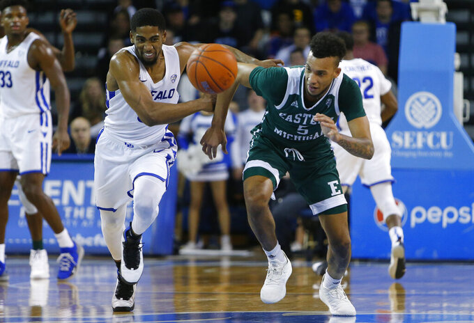 Buffalo guard CJ Massininburg (5) steals the ball from Eastern Michigan forward Elijah Minnie (5) during the second half of an NCAA college basketball game, Friday, Jan. 18, 2019, in Buffalo N.Y. (AP Photo/Jeffrey T. Barnes)