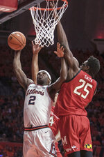 Illinois' Kipper Nichols (2) goes to the basket as Maryland's Jalen Smith (25) defends during the first half of an NCAA college basketball game Friday, Feb. 7, 2020, in Champaign, Ill. (AP Photo/Holly Hart)