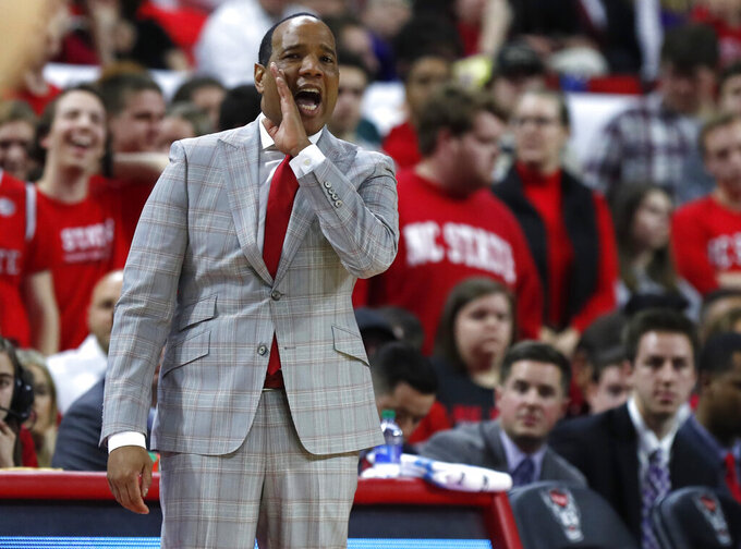 North Carolina State head coach Kevin Keatts yells to his team during the first half an NCAA college basketball game against Notre Dame in Raleigh, N.C., Wednesday, Jan. 8, 2020. (Ethan Hyman/The News & Observer via AP)