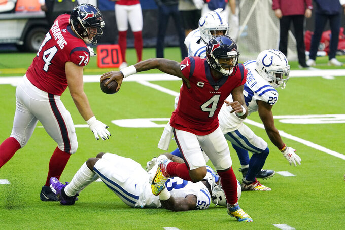 Houston Texans quarterback Deshaun Watson (4) escapes the grasp of Indianapolis Colts outside linebacker Darius Leonard (53) during the first half of an NFL football game Sunday, Dec. 6, 2020, in Houston. (AP Photo/David J. Phillip)
