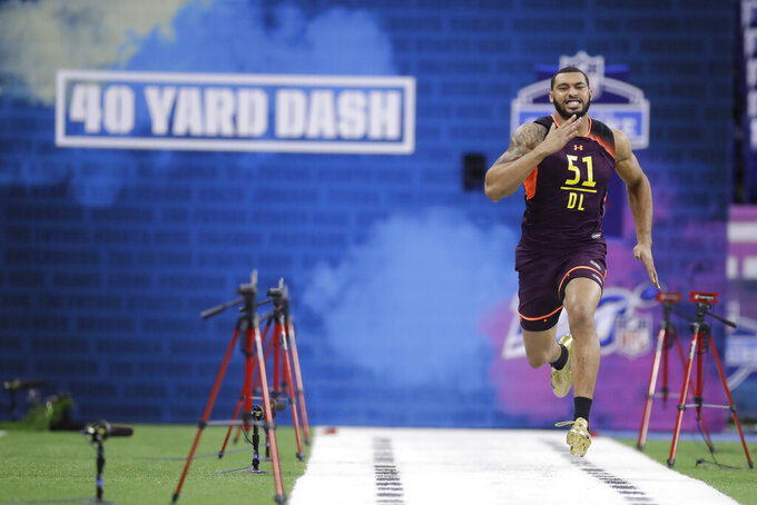 Mississippi State defensive lineman Montez Sweat runs the 40-yard dash during the NFL football scouting combine, Sunday, March 3, 2019, in Indianapolis. (AP Photo/Darron Cummings)