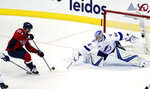 Washington Capitals center Lars Eller (20), from Denmark, has his shot knocked away by Tampa Bay Lightning goaltender Andrei Vasilevskiy (88), from Russia, during the third period of Game 6 of the NHL Eastern Conference finals hockey playoff series, Monday, May 21, 2018, in Washington. The Capitals won 3-0. (AP Photo/Alex Brandon)