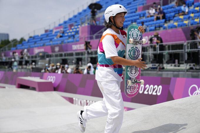 Gold medal winner Momiji Nishiya of Japan walks off the course after winning the women's street skateboarding finals at the 2020 Summer Olympics, Monday, July 26, 2021, in Tokyo, Japan. (AP Photo/Ben Curtis)