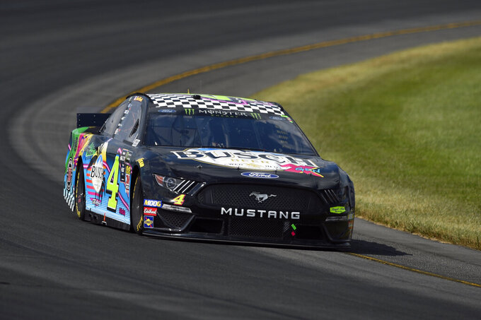 Kevin Harvick (4) drives through Turn 3 during a NASCAR Cup Series auto race, Sunday, July 28, 2019, in Long Pond, Pa. Denny Hamlin won the race. (AP Photo/Derik Hamilton)