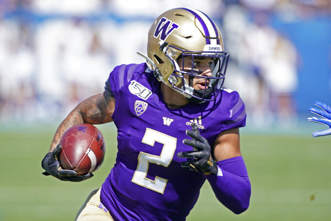 Washington wide receiver Aaron Fuller (2) runs the ball in the first half, during a game against BYU in an NCAA college football game, Saturday, Sept. 21, 2019, in Provo, Utah. (AP Photo/George Frey)