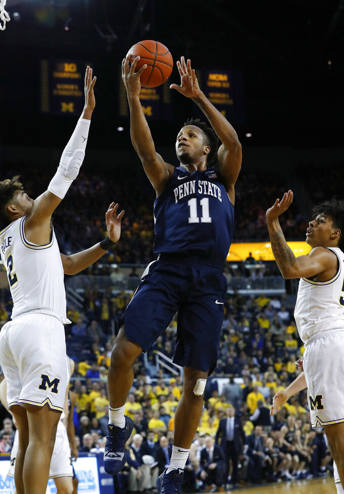 Penn State forward Lamar Stevens (11) drives as Michigan guard Jordan Poole (2) defends during the first half of an NCAA college basketball game in Ann Arbor, Mich., Thursday, Jan. 3, 2019. (AP Photo/Paul Sancya)