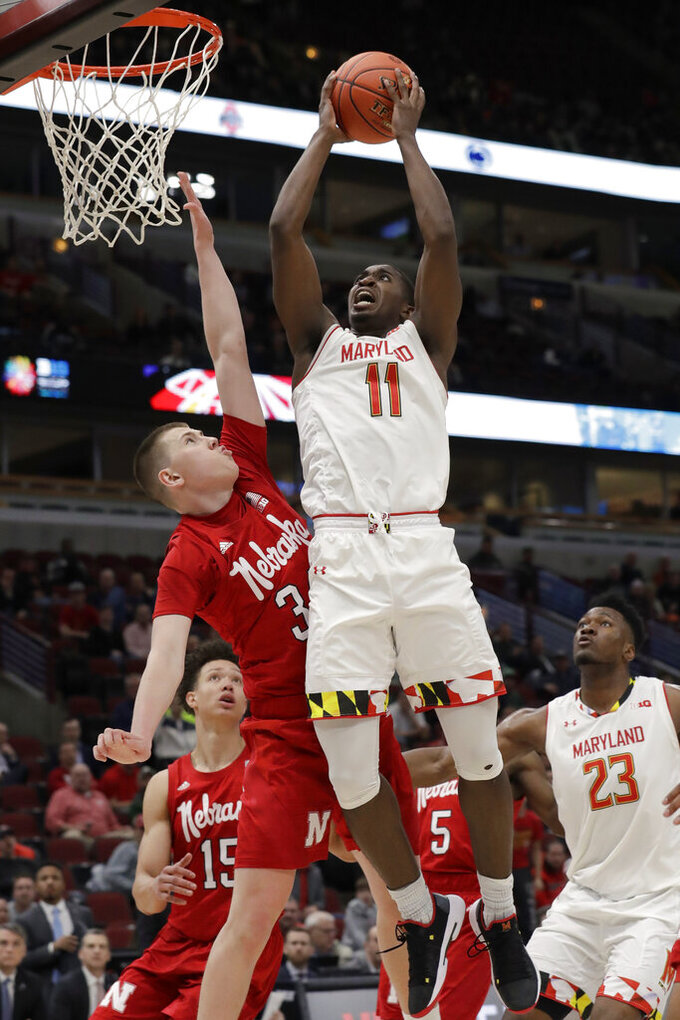Maryland's Darryl Morsell (11) goes up for a shot against Nebraska's Thorir Thorbjarnarson (34) during the second half of an NCAA college basketball game in the second round of the Big Ten Conference tournament, Thursday, March 14, 2019, in Chicago. The Nebraska won 69-61. (AP Photo/Nam Y. Huh)