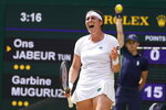 Tunisia's Ons Jabeur celebrates winning a point against Spain's Garbine Muguruza during the women's singles third round match on day five of the Wimbledon Tennis Championships in London, Friday July 2, 2021. (AP Photo/Kirsty Wigglesworth)