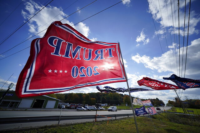 Trump campaign banners wave in the wind along Route 8 in Middlesex Township, Pa., in conservative Butler County on Thursday, Oct. 15, 2020. To win Pennsylvania, President Donald Trump needs blowout victories and historic turnout in conservative strongholds across the state. (AP Photo/Gene J. Puskar)