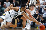Purdue's Grady Eifert, right, and Michigan State's Kenny Goins (25) vie for a loose ball during the first half of an NCAA college basketball game, Tuesday, Jan. 8, 2019, in East Lansing, Mich. (AP Photo/Al Goldis)