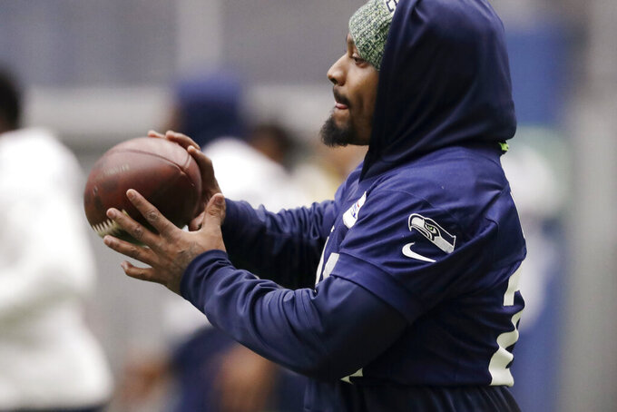 Seattle Seahawks running back Marshawn Lynch catches a football during warmups at the NFL team's practice facility Tuesday, Dec. 24, 2019, in Renton, Wash. When Lynch played his last game for the Seahawks in 2016, the idea of him ever wearing a Seahawks uniform again seemed preposterous. Yet, here are the Seahawks getting ready to have Lynch potentially play a major role Sunday against San Francisco with the NFC West title on the line. (AP Photo/Elaine Thompson)