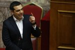 Greece's Prime Minister Alexis Tsipras speaks during a parliament session in Athens, Friday, Feb. 8, 2019. Greek lawmakers are set Friday to approve Macedonia's NATO accession, ending a process to normalize relations between the two neighbors and anchor the country — renamed North Macedonia — firmly within the western sphere of influence. (AP Photo/Thanassis Stavrakis)