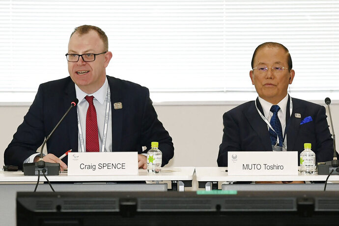 """Chief Executive Officer Toshiro Muto, right, and Craig Spence, head of communications of the International Paralympic Committee, attend a news conference in Tokyo Wednesday, Feb. 5, 2020. Tokyo Olympic organizers said Wednesday they are increasingly concerned about the disruption the fast-spreading virus in China is causing with the games opening in just under six months. """"I am seriously worried that the spread of the infectious disease could throw cold water on the momentum toward the games,"""
