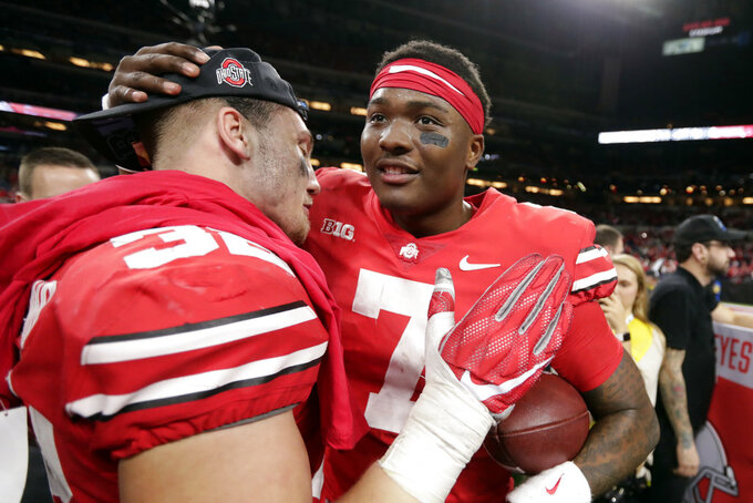 Ohio State quarterback Dwayne Haskins (7) and Tuf Borland (32) celebrate after defeating Northwestern 45-24 in the Big Ten championship NCAA college football game, Saturday, Dec. 1, 2018, in Indianapolis. Ohio (AP Photo/Michael Conroy)