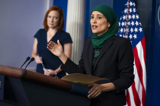 White House press secretary Jen Psaki listens as deputy director of the National Economic Council Sameera Fazili speaks during a press briefing at the White House, Tuesday, June 8, 2021, in Washington. (AP Photo/Evan Vucci)