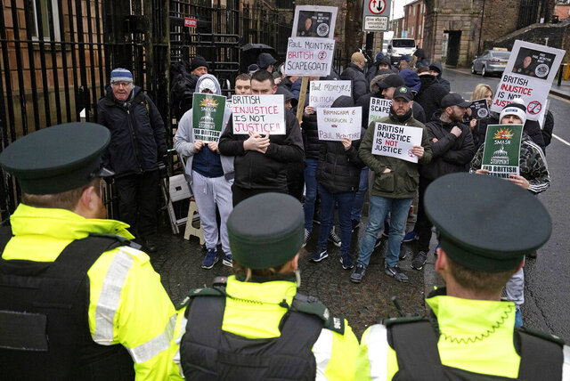 "Supporters of Paul McIntyre protest outside Londonderry Magistrates' Court, where he is appearing charged with the murder of journalist Lyra McKee, in Londonderry, Northern Ireland, Thursday, Feb. 13, 2020. A 52-year-old man appeared in court in Northern Ireland on Thursday in connection with the murder of Lyra McKee, a journalist shot dead during a riot involving Irish Republican Army dissidents last year. Paul McIntyre has been charged with murder, though police say they believe several people were involved and they are still seeking ""evidence to bring the gunman to justice."" (Brian Lawless/PA via AP)"