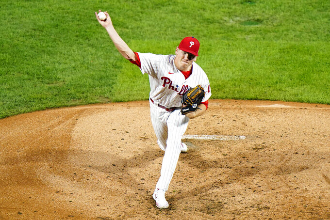 Philadelphia Phillies' Spencer Howard pitches during the third inning of a baseball game against the Washington Nationals, Monday, Aug. 31, 2020, in Philadelphia. (AP Photo/Matt Slocum)