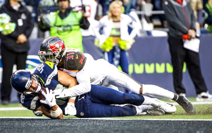 Seahawks tight end Jacob Hollister (48) scores the winning touchdown against Tampa Bay Buccaneers free safety Jordan Whitehead in overtime an NFL football game against the Tampa Bay Buccaneers, Sunday, Nov. 3, 2019, in Seattle. (Dean Rutz/The Seattle Times via AP)