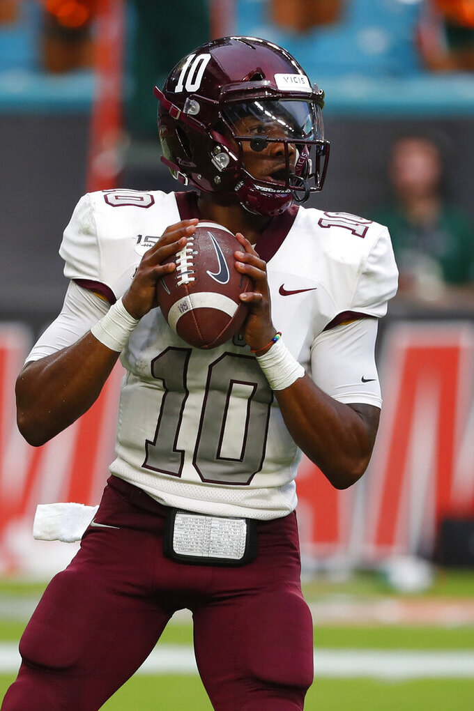 Bethune-Cookman quarterback Akevious Williams looks for an open teammate during the second half of an NCAA college football game against Miami, Saturday, Sept. 14, 2019, in Miami Gardens, Fla. (AP Photo/Wilfredo Lee)