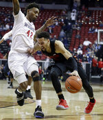 San Diego State's Jeremy Hemsley (42) defends as UNLV's Noah Robotham drives during the second half of an NCAA college basketball game in the Mountain West Conference men's tournament Thursday, March 14, 2019, in Las Vegas. (AP Photo/Isaac Brekken)