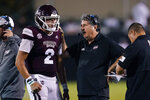 Mississippi State quarterback Will Rogers (2) confers with coach Mike Leach during the second half of the team's NCAA college football game in Starkville, Miss., Saturday, Sept. 11, 2021. (AP Photo/Rogelio V. Solis)