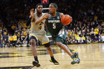 Michigan State guard Cassius Winston (5) drives past Iowa guard Isaiah Moss (4) during the first half of an NCAA college basketball game Thursday, Jan. 24, 2019, in Iowa City, Iowa. (AP Photo/Charlie Neibergall)