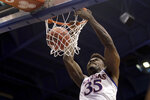 Kansas center Udoka Azubuike (35) dunks the ball during the first half of an NCAA college basketball game against East Tennessee State Tuesday, Nov. 19, 2019, in Lawrence, Kan. (AP Photo/Charlie Riedel)
