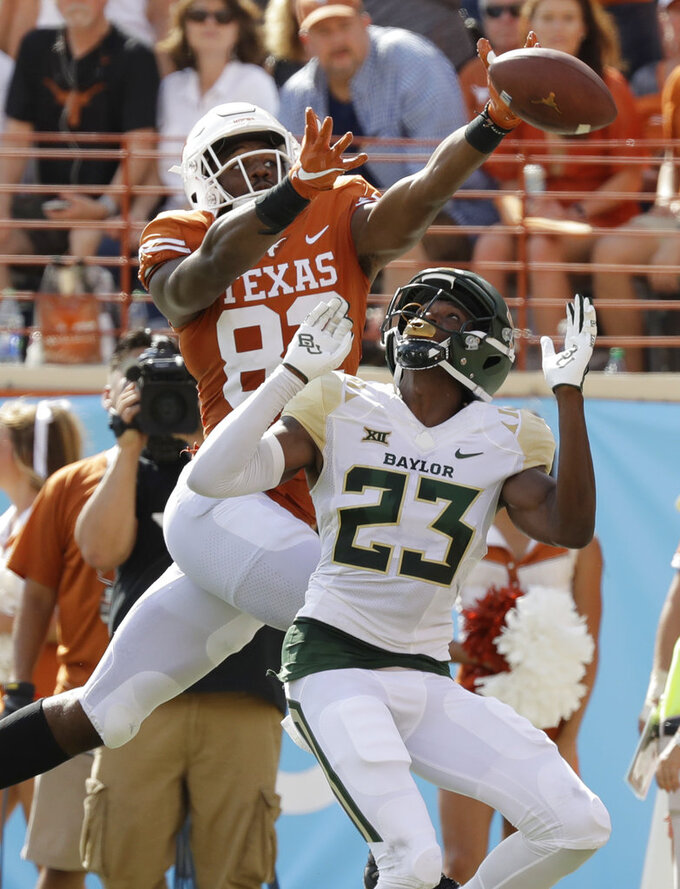 Texas wide receiver Brennan Eagles (82) fails to make a catch as he reaches over Baylor cornerback Derrek Thomas (23) during the first half of an NCAA college football game, Saturday, Oct. 13, 2018, in Austin, Texas. (AP Photo/Eric Gay)