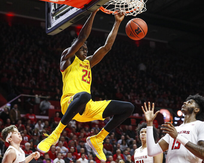 FILE - In this march 3, 2020, file photo, Maryland's Jalen Smith (25) dunks as Rutgers' Myles Johnson (15) watches during the first half of an NCAA college basketball game in Piscataway, N.J. Jalen Smith was selected to the Associated Press All-Big Ten team selected Tuesday, March 10, 2020. (AP Photo/John Minchillo, File)