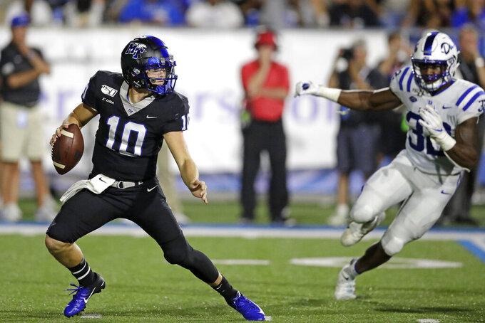 Middle Tennessee quarterback Asher O'Hara (10) scrambles from Duke linebacker Brandon Hill (32) in the first half of an NCAA college football game Saturday, Sept. 14, 2019, in Murfreesboro, Tenn. (AP Photo/Mark Humphrey)