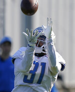 Detroit Lions safety Dean Marlowe catches during a drill at the Lions NFL football camp practice, Wednesday, Aug. 4, 2021, in Allen Park, Mich. (AP Photo/Carlos Osorio)