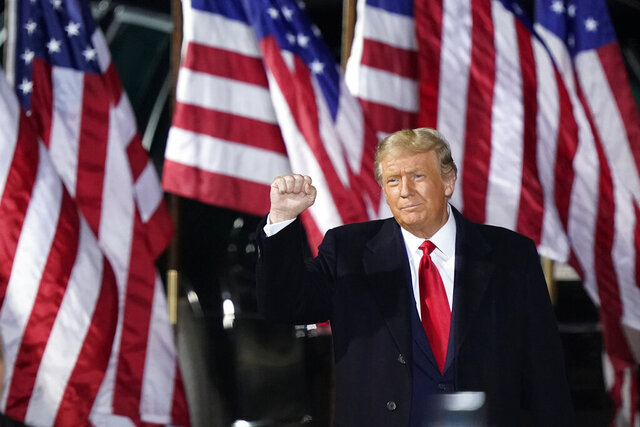 President Donald Trump pumps his fist before speaking at a campaign rally, Monday, Sept. 21, 2020, in Swanton, Ohio. (AP Photo/Tony Dejak)