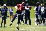 Dallas Cowboys quarterback Dak Prescott (4) catches a pass as he tosses a ball with a member of the staff at the team's NFL football training facility in Frisco, Texas, Wednesday, Aug. 25, 2021. (AP Photo/Tony Gutierrez)