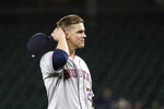 Houston Astros starting pitcher Zack Greinke pulls off his cap after giving up a single to Seattle Mariners' Austin Nola during the ninth inning of a baseball game Wednesday, Sept. 25, 2019, in Seattle. The Astros won 3-0. (AP Photo/Elaine Thompson)