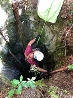 In this photo provided by the Burke County Rescue Squad, a member of the  Burke County Rescue Squad repels down a sinkhole to rescue a trapped dog Sunday, Sept. 20, 2020, at Pisgah National Forest in Morganton, N.C. The dog was not injured, but was starving and dehydrated, according to the rescuers.  (Burke County Rescue Squad via AP)