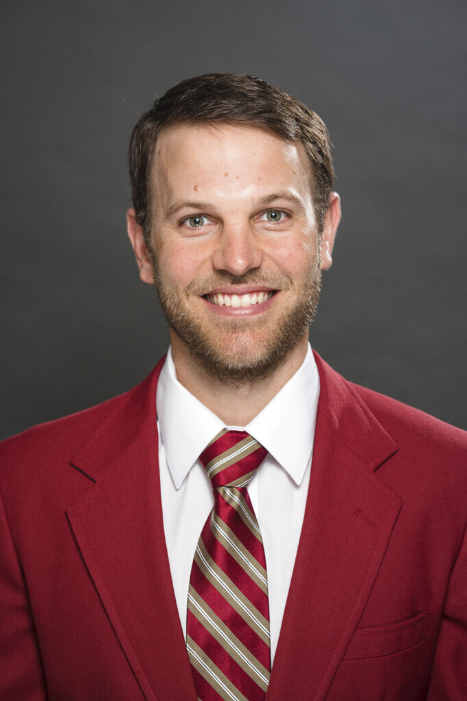 This Feb. 25, 2019 photo provided by University of Southern California Athletics shows new USC offensive coordinator Graham Harrell. Harrell stepped into one of the highest-profile assistant jobs in college football after Kliff Kingsbury left USC without calling a play. The Trojans' new offensive coordinator is working hard to get up to speed in spring practice. (John McGillen/USC Athletics via AP)