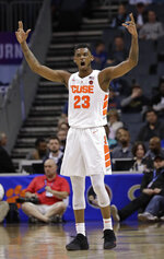 Syracuse's Frank Howard (23) reacts after a basket against Pittsburgh during the first half of an NCAA college basketball game in the Atlantic Coast Conference tournament in Charlotte, N.C., Wednesday, March 13, 2019. (AP Photo/Chuck Burton)