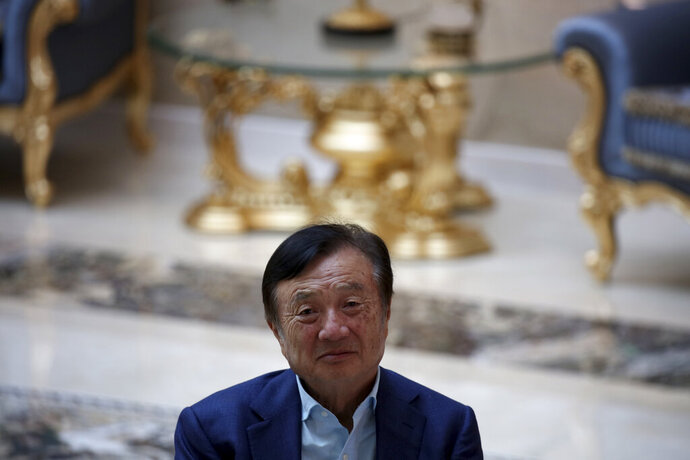 Huawei's founder Ren Zhengfei, looks on during an interview at the Huawei campus in Shenzhen in Southern China's Guangdong province on Tuesday, Aug. 20, 2019. Ren said he expects no relief from U.S. export curbs due to the political climate in Washington but expresses confidence the company will thrive with its own technology. (AP Photo/Ng Han Guan)