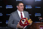 FILE - In this Jan. 2, 2020, file photo, Washington Redskins new head coach Ron Rivera holds up a helmet during a news conference at the team's NFL football training facility in Ashburn, Va. The new Redskins coach took some big swings in free agency but has so far been more focused on incremental additions and subtractions to change the culture within the organization and build for the future. (AP Photo/Alex Brandon, File)