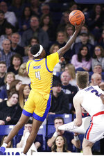 Cal State Bakersfield guard Taze Moore (4) shoots during the first half of an NCAA college basketball game against Gonzaga in Spokane, Wash., Saturday, Nov. 23, 2019. (AP Photo/Young Kwak)