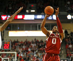 Oklahoma's Christian James (0) shoots a 3-pointer against Texas Tech during the first half of an NCAA college basketball game Tuesday, Jan. 8, 2019, in Lubbock, Texas. (AP Photo/Brad Tollefson)