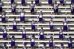 Members of the Kansas State University marching band socially distance as they play before an NCAA college football game between Kansas State and Texas Tech Saturday, Oct. 3, 2020, in Manhattan, Kan. (AP Photo/Charlie Riedel)