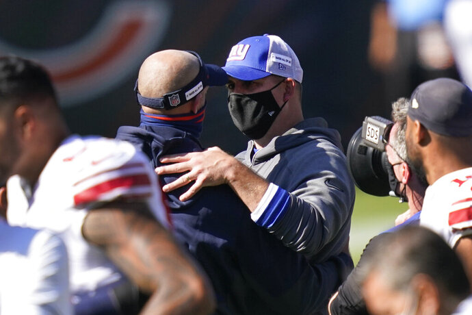Chicago Bears head coach Matt Nagy and New York Giants head coach Joe Judge talk after an NFL football game in Chicago, Sunday, Sept. 20, 2020. Chicago won 17-13. (AP Photo/Charles Rex Arbogast)