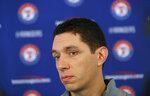"FILE - In this Feb. 15, 2018, file photo, Texas Rangers general manager Jon Daniels speaks to reporters during baseball spring training in Surprise, Ariz. Will there be a place to play whether a draft prospect decides to go, or stay in college? ""I think there's a host of information that you'd want to know, and then that's really where I think the clubs can differentiate themselves,"" Daniels said. (AP Photo/Charlie Neibergall, File)"
