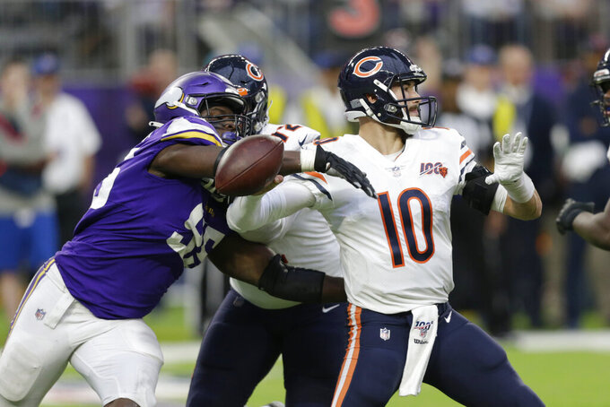 FILE - In this Dec. 29, 2019, file photo, Chicago Bears quarterback Mitchell Trubisky (10) fumbles as he is hit by Minnesota Vikings defensive end Ifeadi Odenigbo, left, during the second half of an NFL football game in Minneapolis. Odenigbo recovered the fumble. Odenigbo's progression from the practice squad accelerated last season with regular playing time and made an even bigger leap forward this spring when stalwart Everson Griffen did not re-sign with the team. (AP Photo/Andy Clayton-King, File)