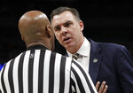 UC Irvine head coach Russell Turner, right, talks with an official during the first half of a first round men's college basketball game in the NCAA Tournament against Kansas State Friday, March 22, 2019, in San Jose, Calif. (AP Photo/Chris Carlson)